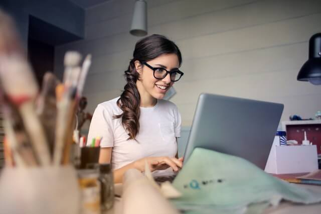 Woman using computer with machine learning techniques in churn prediction