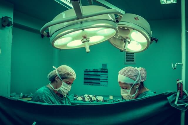 Surgery in healthcare, doctors using artificial intelligence technology