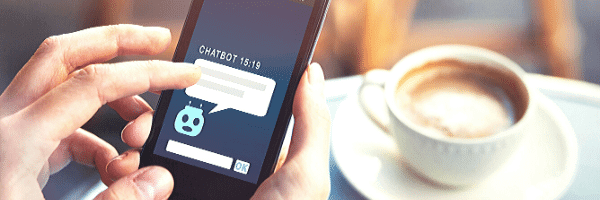 chatbot on a phone, coffee, person typing
