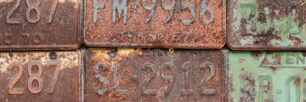dirty, old car license plates