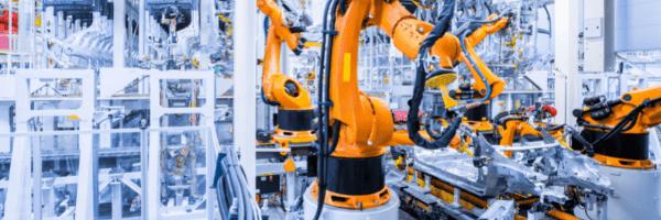 Orange robots taking part in manufacturing processes
