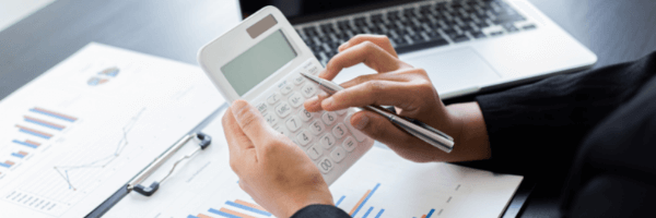 A person calculates a budget